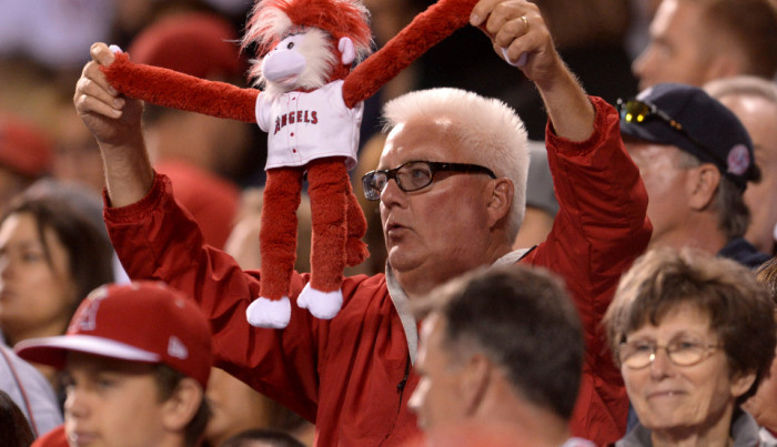 A fan holds up his Rally Monkey during the game against the Yankees. Photo by Matt Brown/Angels Baseball LP