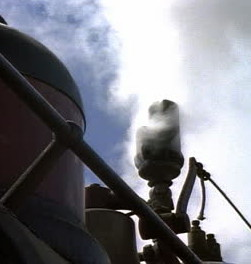 stock-footage-historical-reenactment-in-hill-city-south-dakota-plume-of-white-smoke-puffs-out-of-train-whistle
