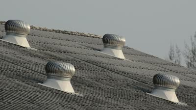stock-footage-old-metal-ventilator-on-the-roof-of-factory